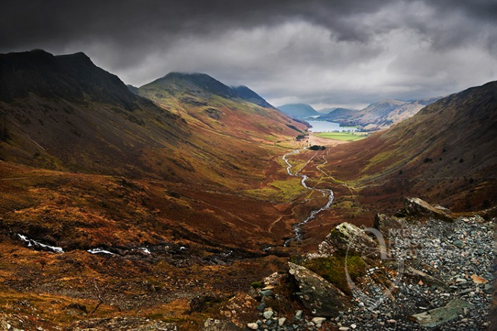Buttermere Valley, Lake District National Park. An example of Landscape, Architecture, Travel and Tourism Photography, using dramatic lighting and striking composition by Nigel Forster ABIPP. Commission Nigel Forster ABIPP to capture your business, event, attraction or location with dramatic use of light and striking composition.
