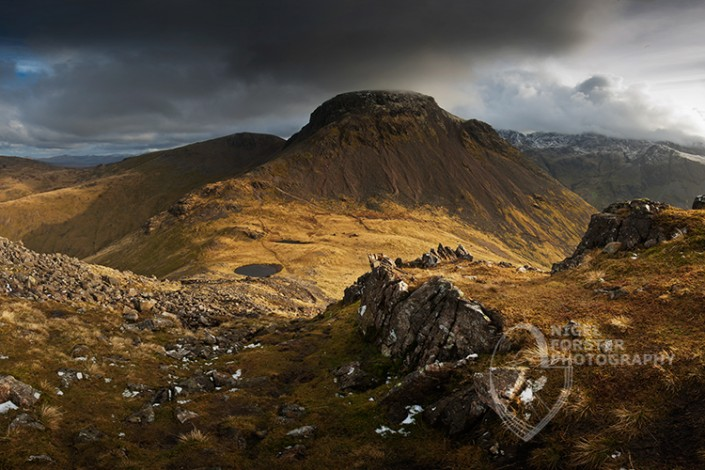 Great Gable, Lake District National Park. An example of Landscape, Architecture, Travel and Tourism Photography, using dramatic lighting and striking composition by Nigel Forster ABIPP. Commission Nigel Forster ABIPP to capture your business, event, attraction or location with dramatic use of light and striking composition.
