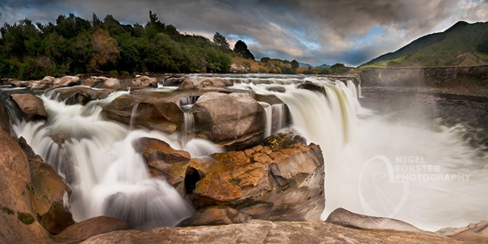 Maruia Falls, Nelson National Park,New Zealand. An example of Landscape, Architecture, Travel and Tourism Photography, using dramatic lighting and striking composition by Nigel Forster ABIPP. Commission Nigel Forster ABIPP to capture your business, event, attraction or location with dramatic use of light and striking composition.