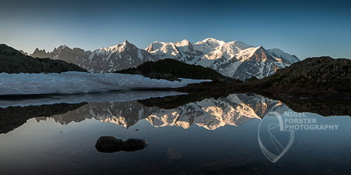 The Mont Blanc Range, Alps Landscapes. An example of Landscape, Architecture, Travel and Tourism Photography, using dramatic lighting and striking composition by Nigel Forster ABIPP. Commission Nigel Forster ABIPP to capture your business, event, attraction or location with dramatic use of light and striking composition.