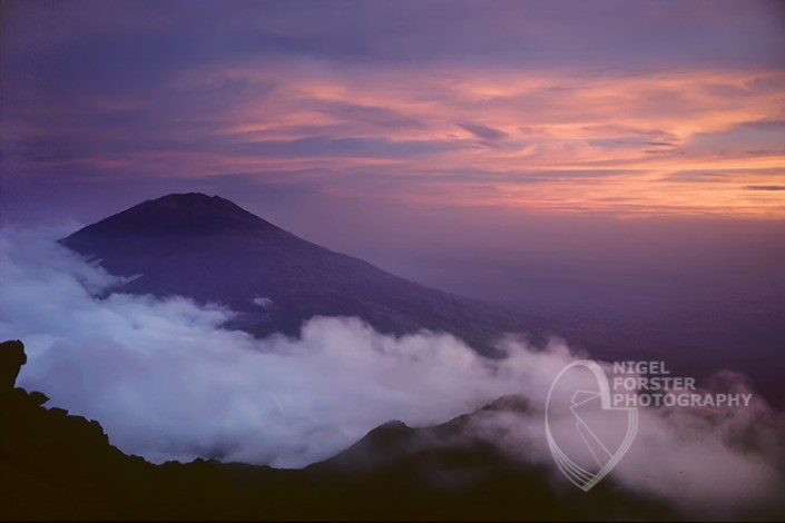 Mount Merapi on Bali, Indonesia. An example of Landscape, Architecture, Travel and Tourism Photography, using dramatic lighting and striking composition by Nigel Forster ABIPP. Commission Nigel Forster ABIPP to capture your business, event, attraction or location with dramatic use of light and striking composition.