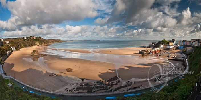 Tenby Summer Panorama. An example of Landscape, Architecture, Travel and Tourism Photography, using dramatic lighting and striking composition by Nigel Forster ABIPP. Commission Nigel Forster ABIPP to capture your business, event, attraction or location with dramatic use of light and striking composition.
