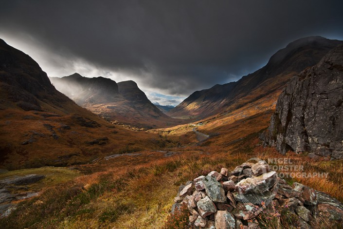 The Three Sisters, Glencoe, Scotland, UK. An example of Landscape, Architecture, Travel and Tourism Photography, using dramatic lighting and striking composition by Nigel Forster ABIPP. Commission Nigel Forster ABIPP to capture your business, event, attraction or location with dramatic use of light and striking composition.