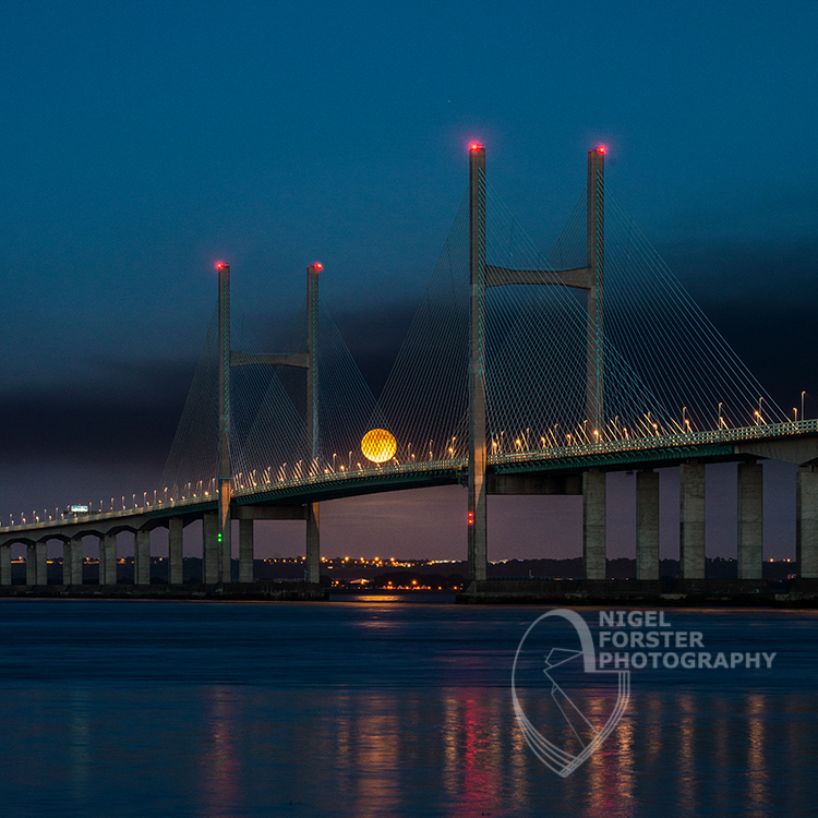 The Second Severn Crossing with the moon rising. An example of Landscape, Architecture, Travel and Tourism Photography using dramatic lighting by Nigel Forster ABIPP. Commission Nigel Forster ABIPP to capture your business, event, attraction or location with dramatic use of light and striking composition.